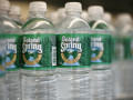 UNITED STATES - JULY 18:  Bottles of Poland Spring water, are arranged on a shelf in New York on Tuesday, July 18, 2006. Poland Spring, bottled at multiple sources in the state of Maine is Nestle's biggest and the No. 1 bottled water brand in the U.S. with sales of at least 500 million Swiss francs ($411) in 2004.  (Photo by Tom Starkweather/Bloomberg via Getty Images)